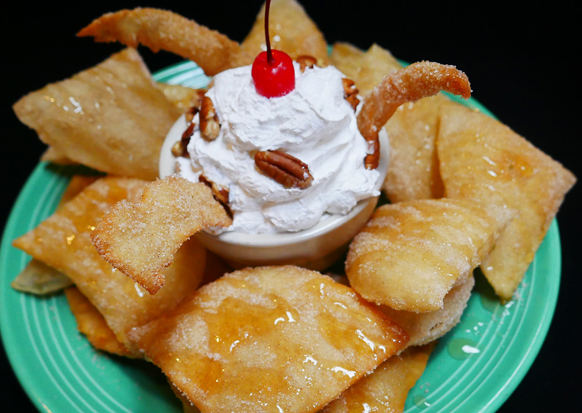 Sopapillas with whipped cream and honey